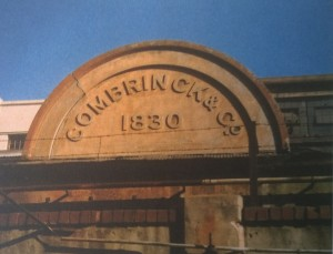 The arch surmounting the entrance to the railway siding within Combrinck's Dock Road building, built in 1896.  The date, 1830, refers to the foundation of the butchery at the shambles.