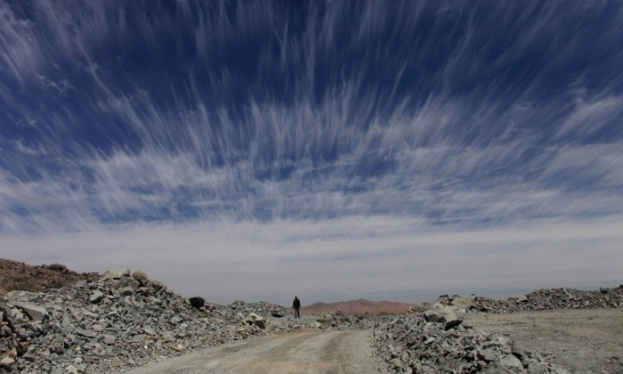 A man walks down a dirt road in the Atacama Desert. Despite being one of the most inhospitable places on earth, the Atacama is still mined: in 2010 this made world-wide news, when the Copiapó mining accident led to the dramatic rescue of 33 trapped miners (AP Photo/Dario Lopez-Mills).