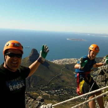 Eben and T joining Will for an abseil down one of the cliffs of Table Mountain.