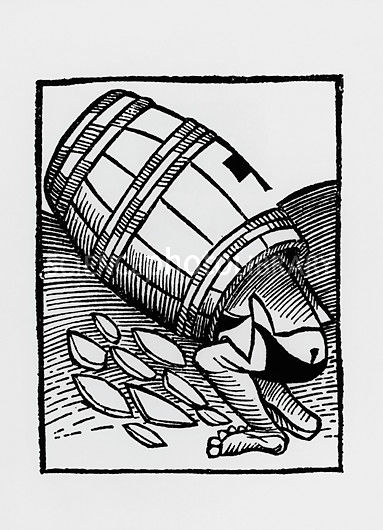Man collecting tartar from a empty wine barrel