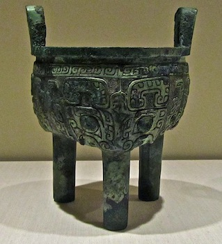 an ancient style of chinese bronze tripod called a ding