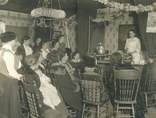 Farm_and_Home_Bureaus-_Meat_canning_demonstration_at_meeting_of_the_Akron_Home_Economics_(cropped)_(3856810708)